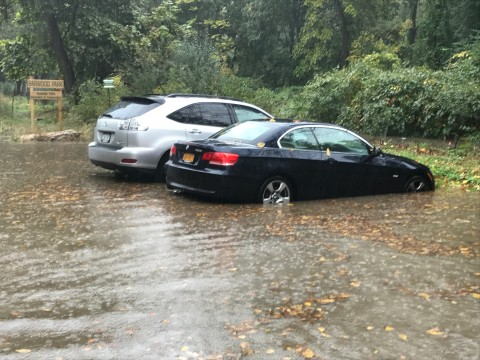 Suzman's car in comparison with another student's who could get out of the flooding.