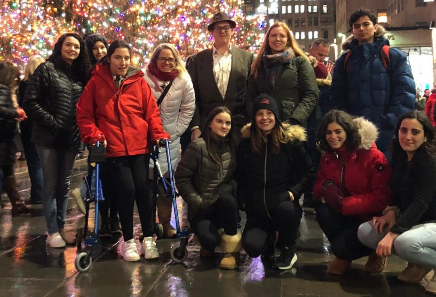 Juniors, seniors and PE teachers in the modern dance unit took a field trip to see an Alvin Ailey show in December. Before the performance, they posed in front of the Rockefeller tree. PC: Nicole Roemer