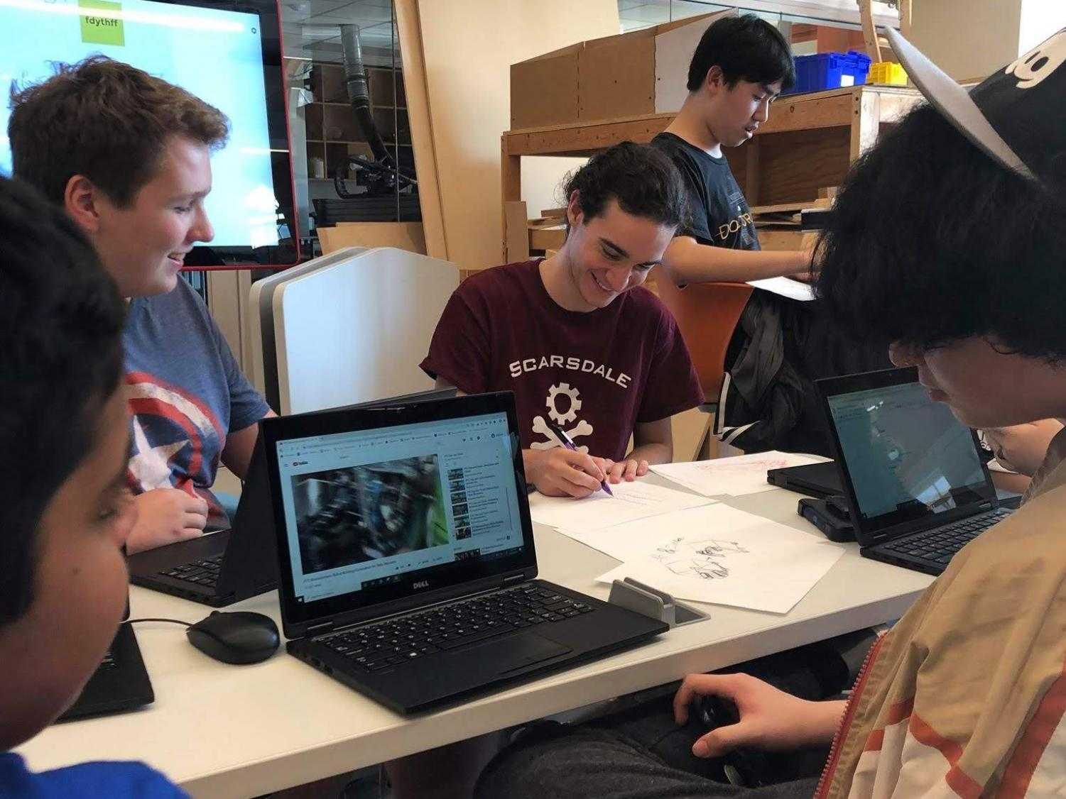 Members of the Robo Raiders brainstorm new designs. The Robotics Club is one of many extracurriculars advancing STEM knowledge at SHS.