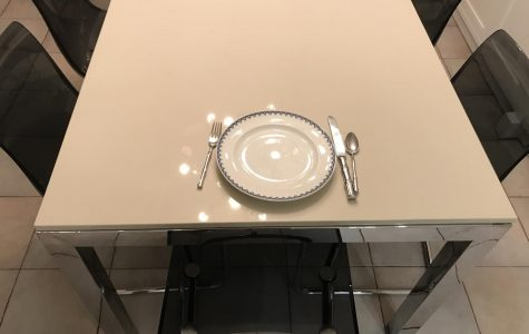 A child sits down for dinner without any siblings to accompany them.
