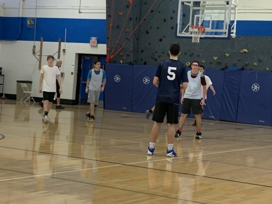 Kol-Ami and Westchester Reform Temple play against each other in a basketball game within the Temple Basketball League.