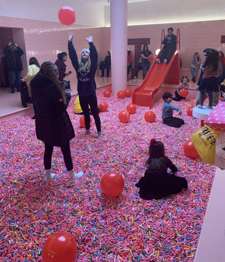 Visitors can wade through a pool of sprinkles at the end of their tour.