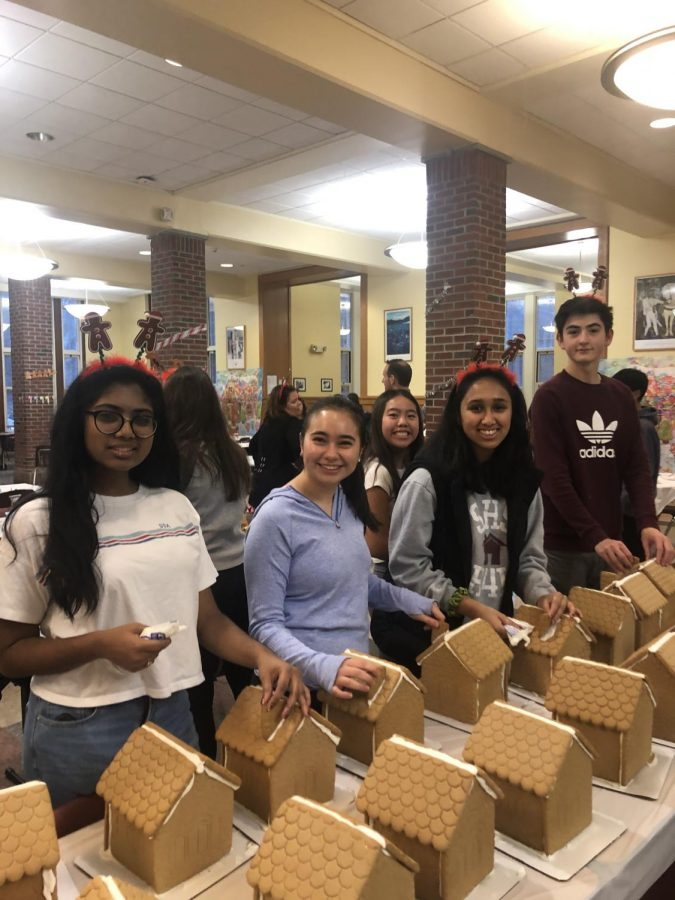 SHS+students+and+families+at+the+Habitat+for+Humanity+annual+gingerbread+house+decorating+event.+
