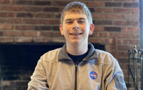 Wolf Cukier '20, proudly sporting his NASA apparel in his home here in Scarsdale. The SHS senior has plans to continue his studies in astrophysics next September when he starts college.
