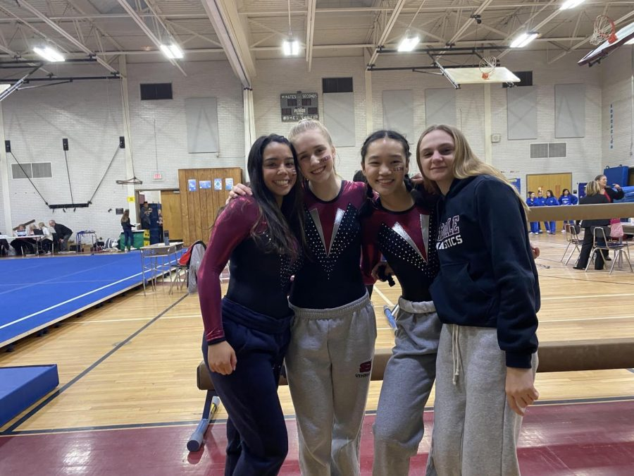 SHS gymnastics team members Jordy Love '20, Claire Scarcella '22, Adrianna Cha '23, and Charlotte Bonanno '21