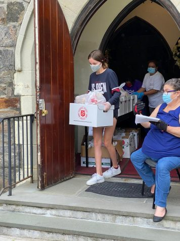 Scarsdale Sophomore Lydia Doherty delivering food to the Salvation Army.