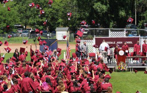 SHS Seniors throw their graduation caps during the Class of 2019 graduation ceremony.
