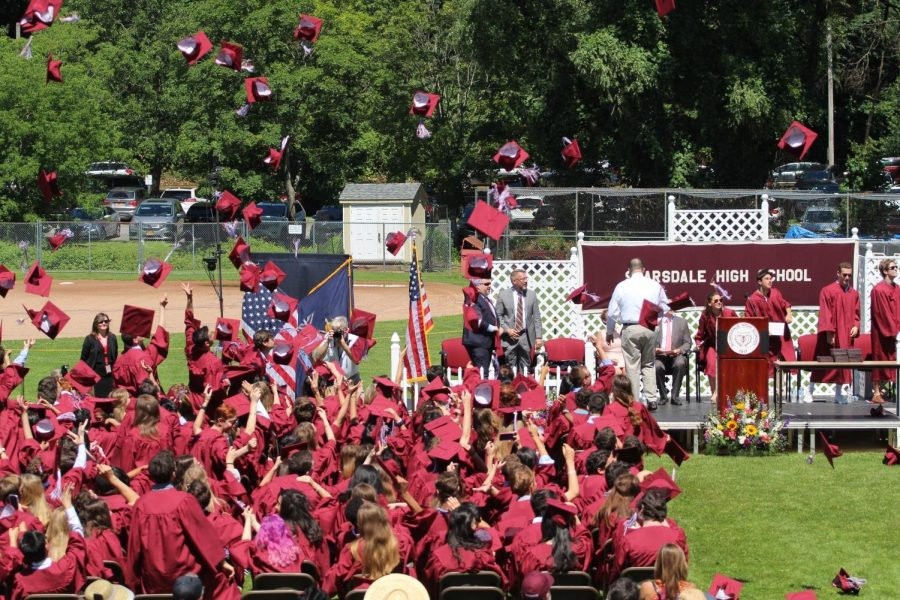SHS Seniors throw their graduation caps during the Class of 2019 graduation ceremony.
