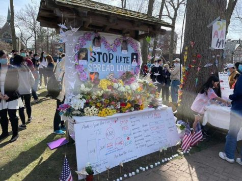 People leave flowers to commemorate those murdered in the Atlanta shooting and other victims of hate crimes.
