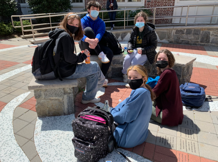 A group of friends eating lunch outside the Learning Commons.