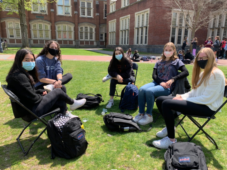 Students spending time outside during lunch near the Brewster entrance.
