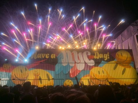 Behind graphic art on multiple cargo crates, fireworks from the Grubhub stage close J Balvin's performance.