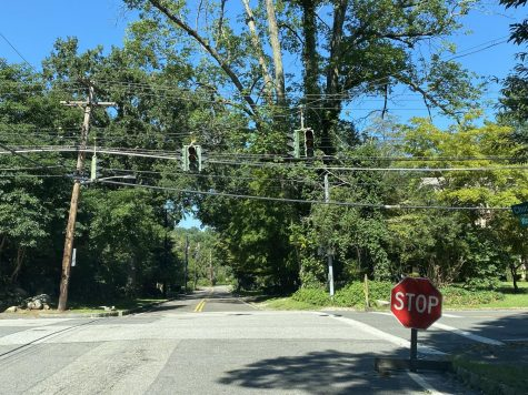 The storm caused power outrages and prevented traffic lights from operated; makeshift stopped signs were put up to ensure safety of residents.